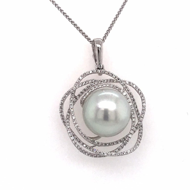 18K White gold pendant featuring one South Sea Pearl measuring 13-14 mm flanked with 186 round brilliants weighing 0.68 carats.  Color G-H  Clarity SI  Pearl can be changed to a Pink, Golden or Tahitian Pearl upon request. Price subject to change.