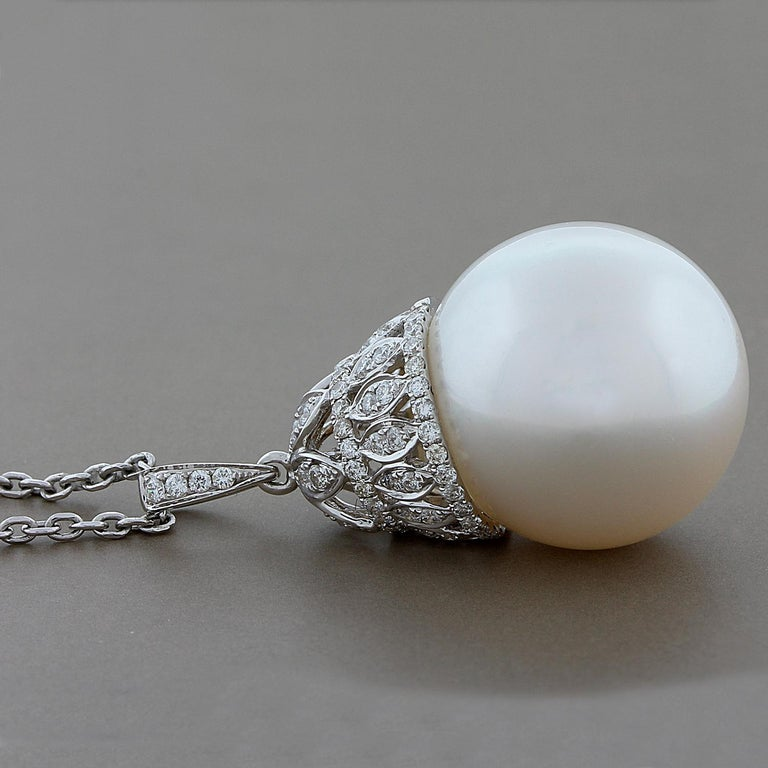 This feminine pendant features a lustrous 16.5 mm South Sea pearl with 0.40 carats of VS clarity round diamonds.  The pearl is lustrous and uniform in surface color all around.  A royal design set in 18K white gold.   Chain Length: 18