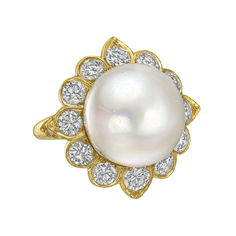 South Sea pearl and diamond suite of jewelry in 18k yellow gold, comprising a necklace, earrings and a ring of foliate design, by Van Cleef & Arpels, circa 1970.  Necklace featuring four white South Sea pearls and two gray South Sea pearls with