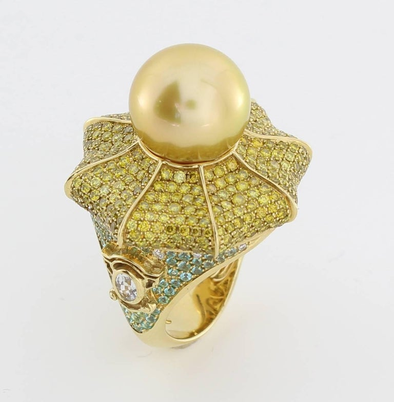 The Catherine Palace Ring is from the AUTORE Metropolitan Collection and is inspired by the Catherine Palace in St Petersburg, Russia.  This piece is crafted in 18k Yellow Gold with White Sapphires (0.33ct), White Diamonds (H SI 0.1ct Brilliant