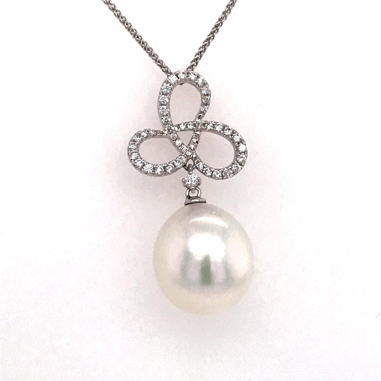 18K White gold pendant featuring one South Sea Pearl measuring 13-14 mm with 43 round brilliants weighing 0.36 carats.  Color G-H  Clarity SI  Pearl can be changed to a Pink, Golden or Tahitian Pearl upon request. Price subject to change.