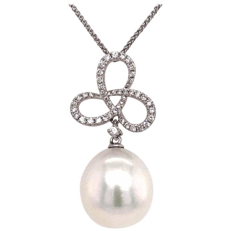 South Sea Pearl Diamond Swiral Pendant 0.36 Carat 18 Karat White Gold For Sale