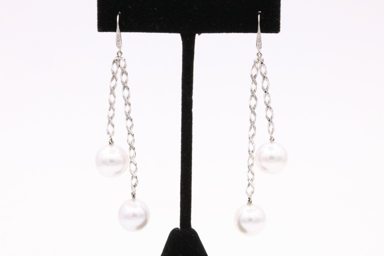 Contemporary South Sea Pearl Diamond Swirl Drop Earrings 0.10 Carats 14 Karat White Gold For Sale