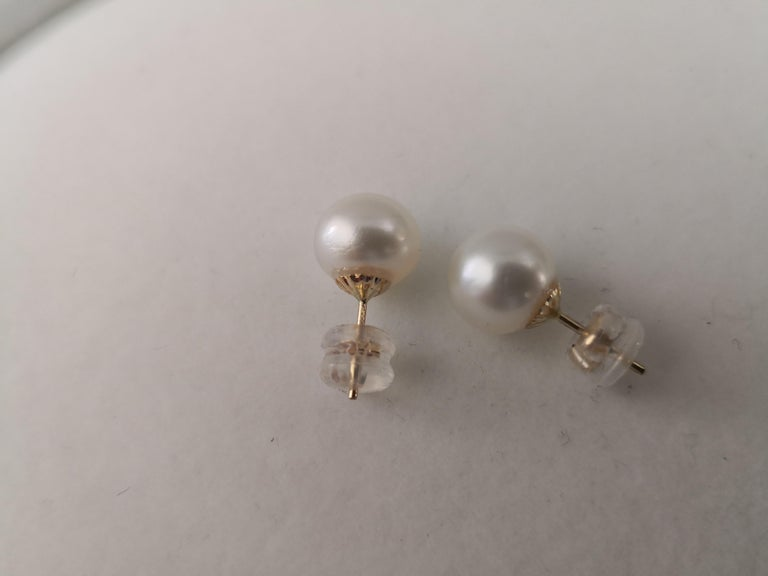 - Natural Color South Sea Pearls earrings  - Origin: Australian ocean waters  - Produced by Pinctada Maxima Oyster  - 18K Yellow Gold mounting  - Size of Pearls 10  mm of diameter  - Pearls of near round shape  - High natural luster and orient