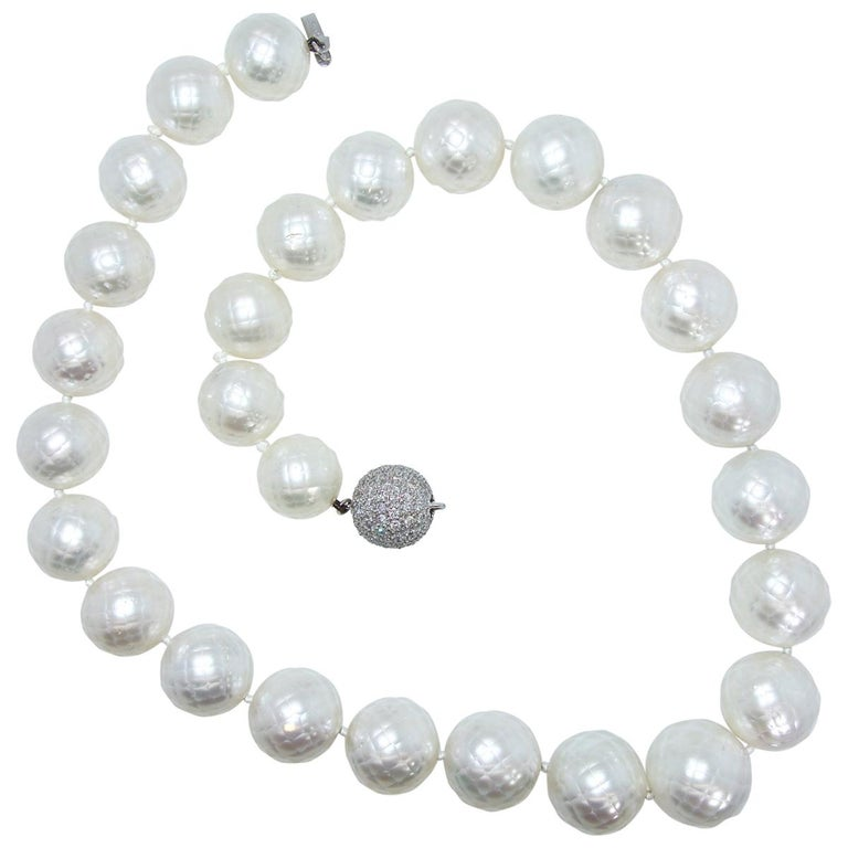 South Sea Pearls highly unusual faceted natural South Sea pearl strand, (accompanied by a certificate), 30 in count (two are included but not strung), these fine pearls display a deep nacre which makes each pearl luminous.  They range from 14 up to
