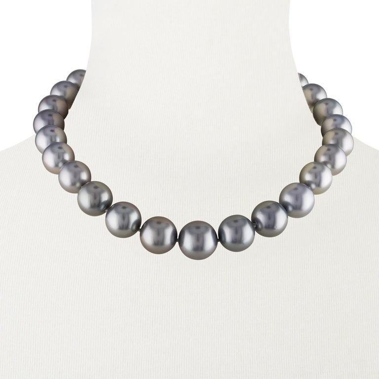 This lustrous necklace features very large South Sea Tahitian round pearls measuring 14.1x17mm. These high luster, spotless pearls have a beautiful silver color, rare among Tahitian pearls. The pearls are strung with a 14K white gold corrugated ball
