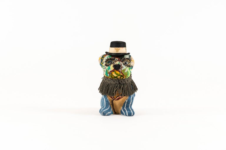 Billy Small Dog is embellished with bright cheeky vintage needlepoint, crewel work, indigo, and antique metallic fringe trim. Billy has a removable hat. Dimensions listed are for Billy only and not wearing his hat.  Mary Lou Marks is mother hen