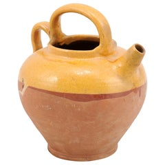 Southern French 19th Century Olive Oil Pot with Yellow Glaze and Two Handles