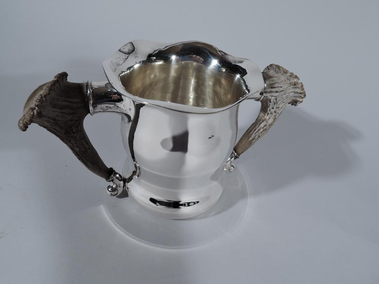 Turn-of-the-century sterling silver trophy cup. Made by Gorham in Providence. Gentle baluster with wavy rim. Antler side handles set in silver mounts. On front engraved presentation in Hebrew-style letters: Thomasville GA / Country Club / Live