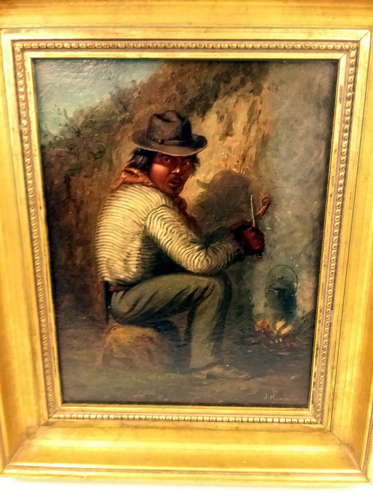 A beautiful signed oil on canvas by artist Joseph A. Harrington, depicting a south-west Indian traveler peering over his shoulder at the viewer as if suspicious of their presence, as if the painter snuck up on the unpropitious camper, hassling the
