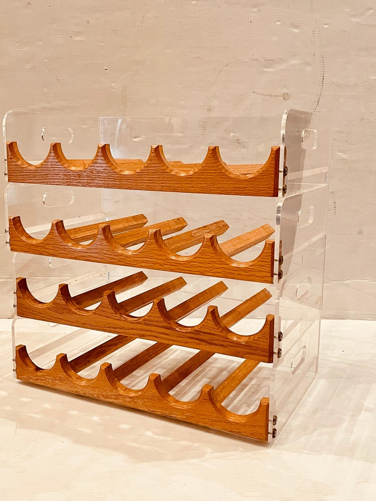 American Space age, Postmodern lucite and oak 20 bottle capacity stackable wine rack. Versatile elegant and simple. Each carrier its 4.75