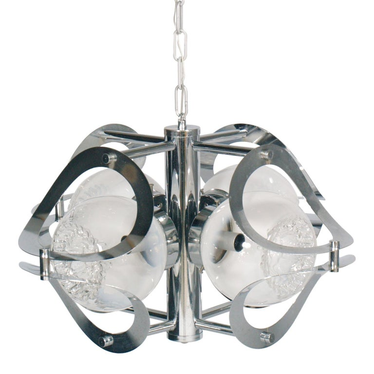 1970s chandelier by Mazzega Murano in chromed steel and Murano glass, 4-light, with overhauled electrical system  Measures cm: Height 90/32, diameter 48   Mazzega Murano is famous for their gorgeous glass lamps, each handcrafted, as well as