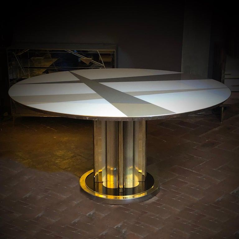 The mosaic glass top is in four different colors (sand, hazelnut, taupe and light grey).  The table pedestal/leg can be removed for an easier shipping process.