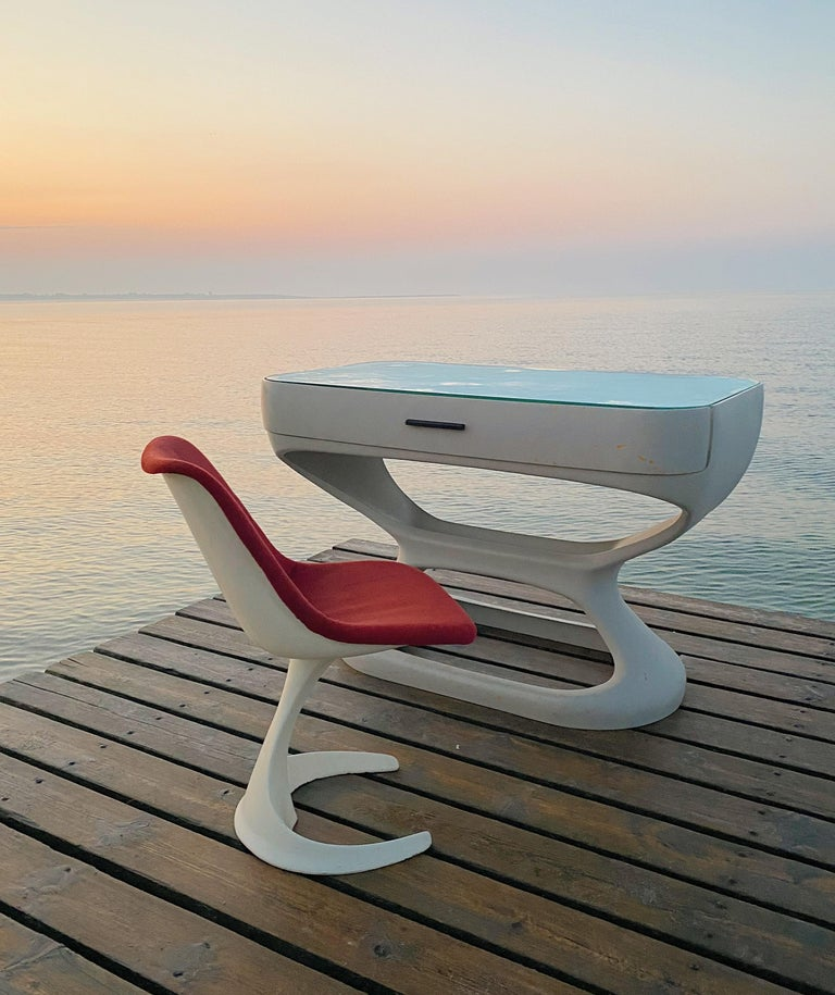 Cool and elegant set of two Space Age chairs made in Spain by Felpam SL start, 1970s.   Red velvet upholstery light worn and with stains to the fabric.   Off white shell made of fiberglass inside cast aluminum and the chairs are heavy and very