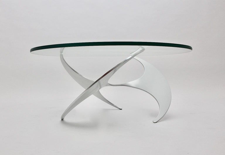 A Space Age vintage silver aluminum glass coffee table or sofa table, which was designed by Knut Hesterberg for Ronald Schmitt, circa 1964, Germany.
