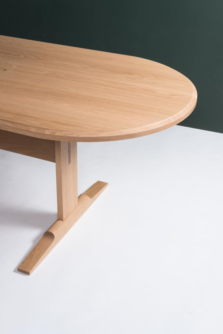 The Spade Dining table is a modern take on the classic trestle table. Solid wood joinery combined with careful shaping and clean lines give this table it's graceful appearance yet substantial strength.   The white oak table pictured is finished in