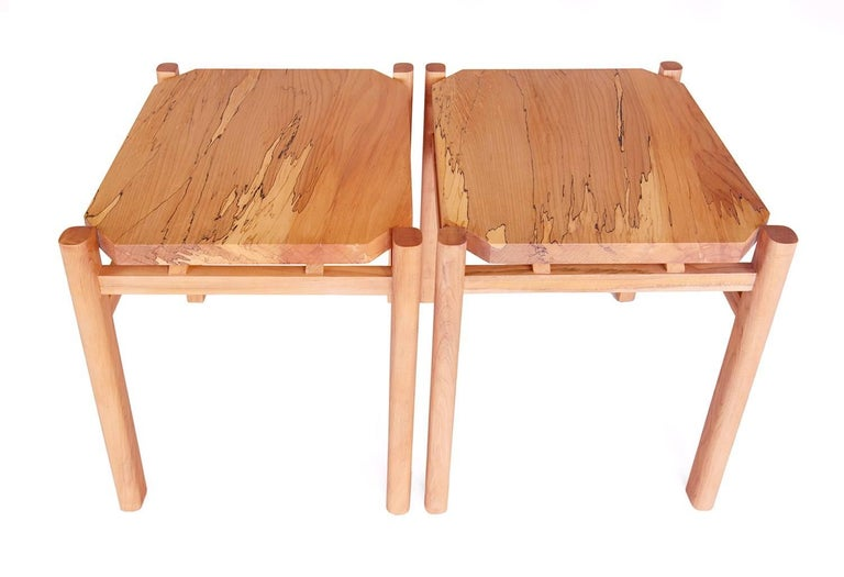 New York Heartwoods' spalted maple Simard side or end tables are modern yet timeless, have faceted tops nested between teardrop-shaped posts, and are influenced by contemporary, mid-century and Asian design. Each is sold individually and is