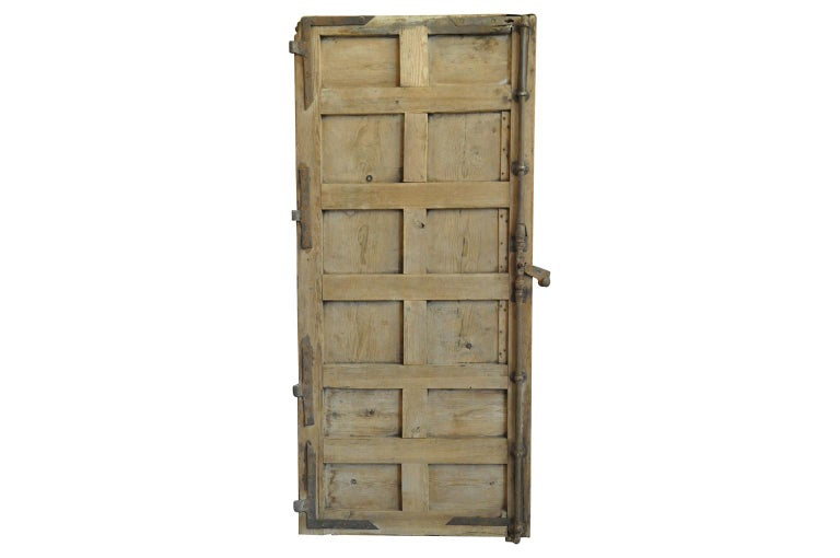 A very handsome 17th century door from the Catalan region of Spain. Soundly constructed from Meleze wood with wonderful iron hardware and hinges. A wonderful accent to add charm to any entry, wine cellar, pantry or cabinet.