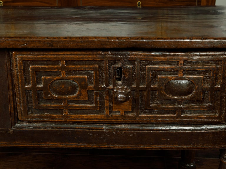A Spanish wooden console table from the early 19th century, with two drawers and carved accents. Created in Spain during the early years of the 19th century, this console table features a rectangular top with great aging, sitting above two drawers