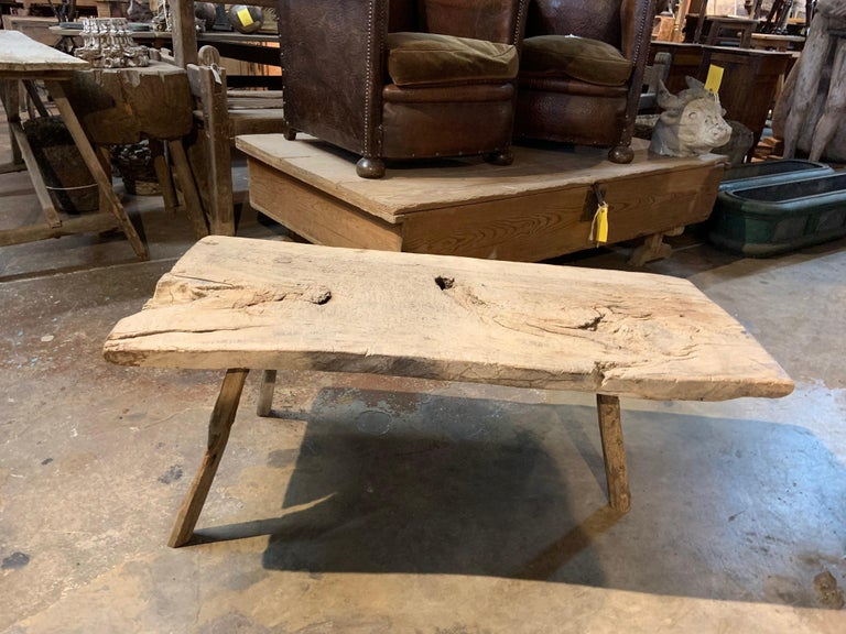 A very charming 18th century primitive work table or coffee table from the Catalan region of Spain. A very unique construction in beautiful olive wood with three legs - sound and sturdy. Terrific texture and patina. A wonderful accent piece for any