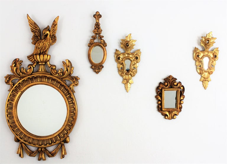 Beautiful carved wood small mirror finished with scroll decorations at the frame and gold leaf. It has been restored to preserve its original antique patina. Interesting for collectors and beautiful placed with other miniature mirrors creating a