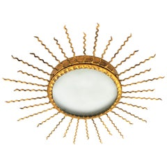 Spanish, 1950s Gilt Iron Sunburst Mirror and Light Fixture with Curly Rays
