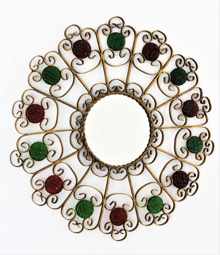 Mid-Century Modern Spanish 1950s Wrought Iron Scroll Motif Mirror Accented by Red and Green Glasses For Sale