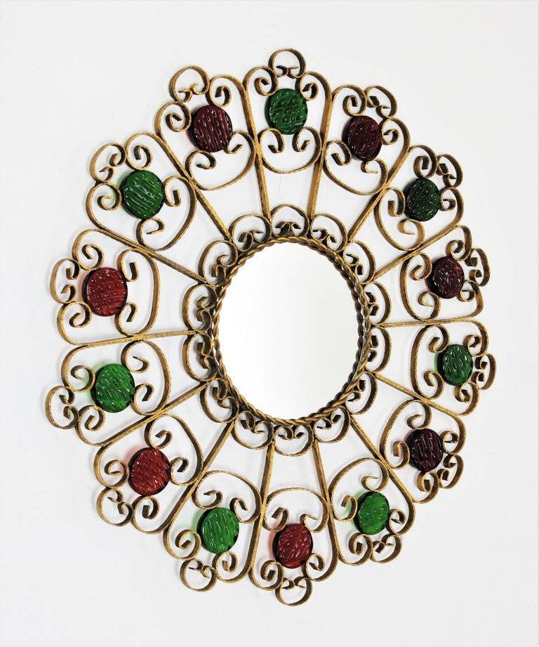 Spanish 1950s Wrought Iron Scroll Motif Mirror Accented by Red and Green Glasses In Good Condition For Sale In Barcelona, ES
