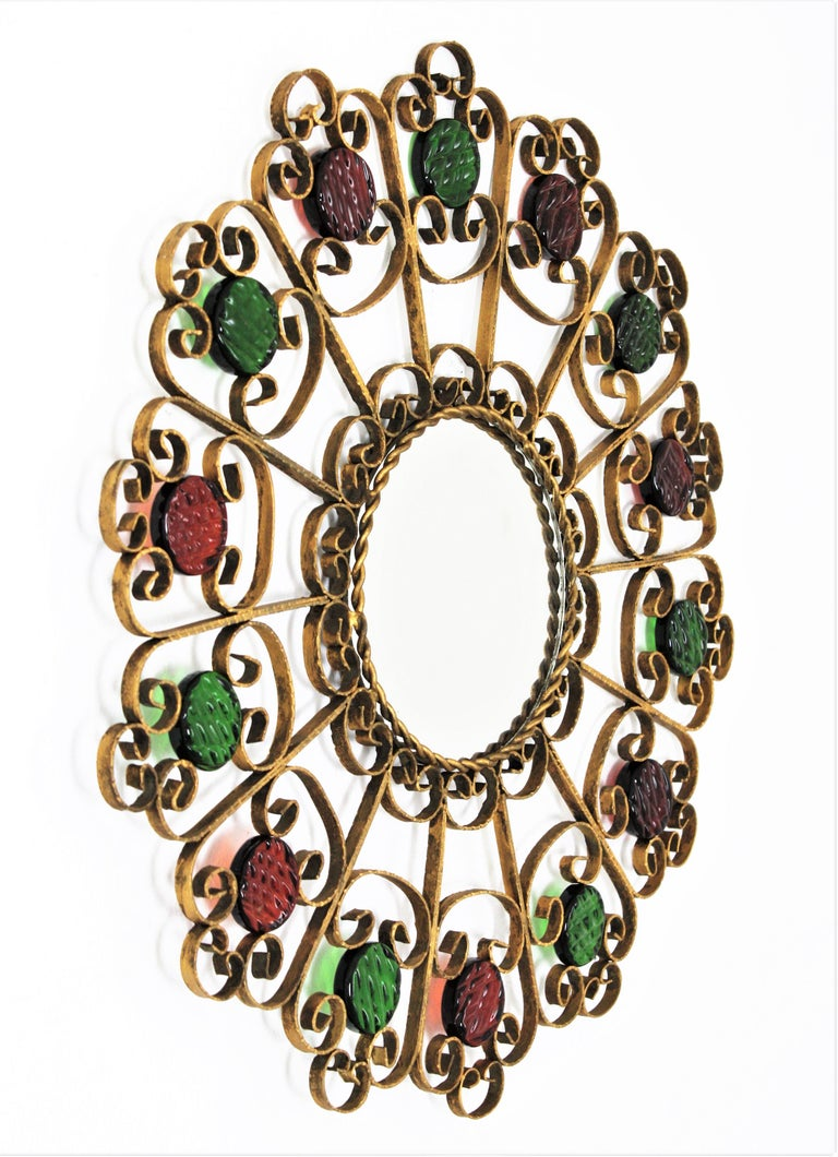 20th Century Spanish 1950s Wrought Iron Scroll Motif Mirror Accented by Red and Green Glasses For Sale