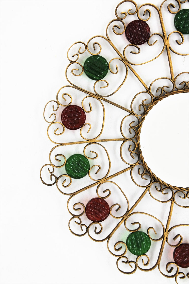 Spanish 1950s Wrought Iron Scroll Motif Mirror Accented by Red and Green Glasses For Sale 1