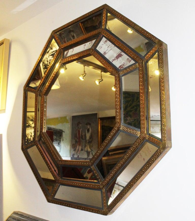 Spanish, 1980s Bedoya Arte signed octagonal mirror Elegant handcrafted octagonal bronze on wood mirror with circular decorations.