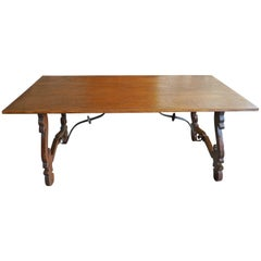 Spanish 19th Century Dining Table with Scalloped Sloped Legs and Iron Supports