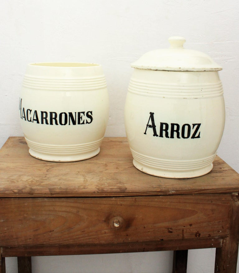 A set of two large glazed ceramic kitchen canisters / storage pots. Spain, circa 1890. A highly decorative set of two antique kitchen pots used for storage: Macarrones (macaroni) and Arroz (rice). Lovely to be used for storage, decorative purposes