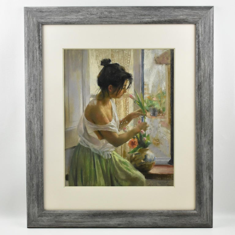 Pastel painting on paper by Vicente Romero Redondo (1956 -), titled 'young girl at the window', signed bottom right corner 'V. Romero'. Lovely romantic composition with young lady seated nearby a window placing flowers in a vase.  Modern wood