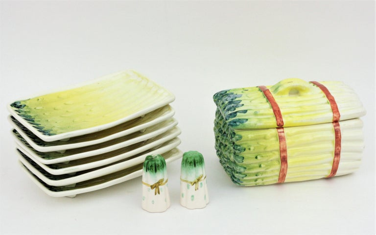 Eye-catching Mid-Century Modern asparagus design glazed ceramic serving set, Spain, 1950s-1960s A set of 6 asparagus plates, a server with lid and a salt and pepper shakers set. The asparagus tureen with lid has a very realistic design. This set