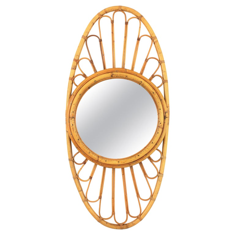 Mid-Century Modern bamboo oval mirror with sunburst decoration at the frame, Spain, 1960s.
