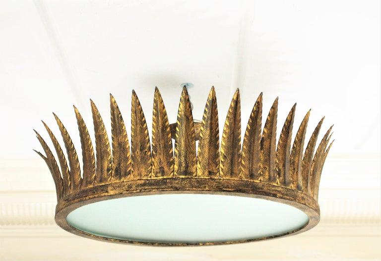 Glass Spanish Brutalist Wrought Gilt Iron Large Crown Light Fixture / Chandelier For Sale