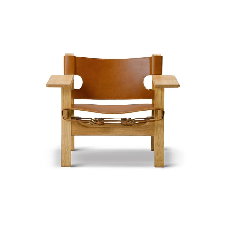 The Spanish chair frame is available in various solid wood options: oak black lacquered, oak standard lacquer, oak smoked and oiled, oak soap treated, oak oil treated clear, and oak white oiled. The saddle leather seat and back are available in