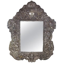 Spanish Colonial Baroque Repoussé Silver Mirror Frame with Allegories