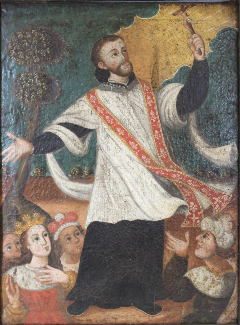 Spanish Colonial oil on canvas painting depicting the Spanish Jesuit priest and Saint Peter Claver. The painting shows the saint in his priest attire, holding up a crucifix in ecstasy, surrounded by noblemen at his feet. The painting is set within