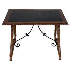 Spanish Farm Table with Iron Stretchers and Hand Carved Top and Ebonized
