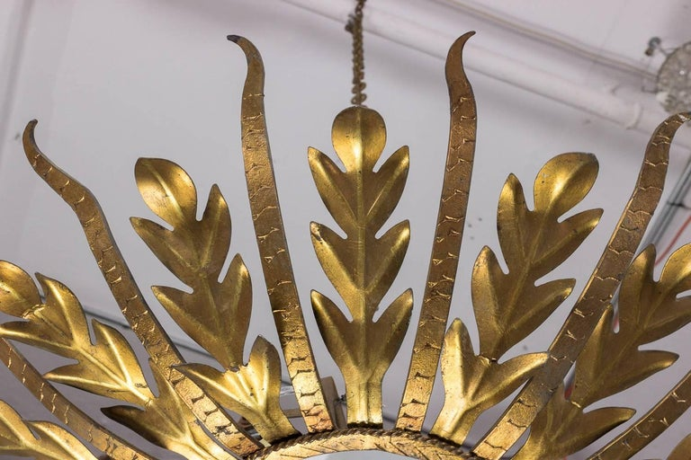 Mid-Century Modern Spanish Gilt Metal Sunburst Ceiling Fixture with Frosted Glass For Sale