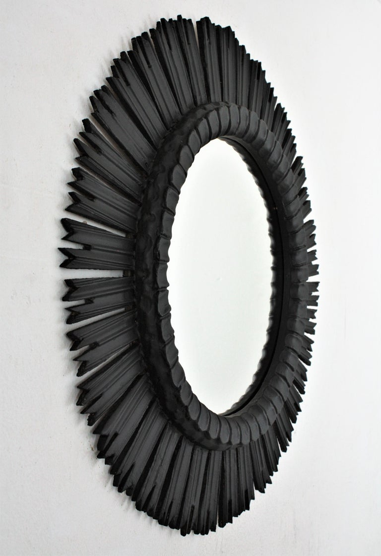 Carved Spanish Large Sunburst Mirror in Black Patina, 1940s
