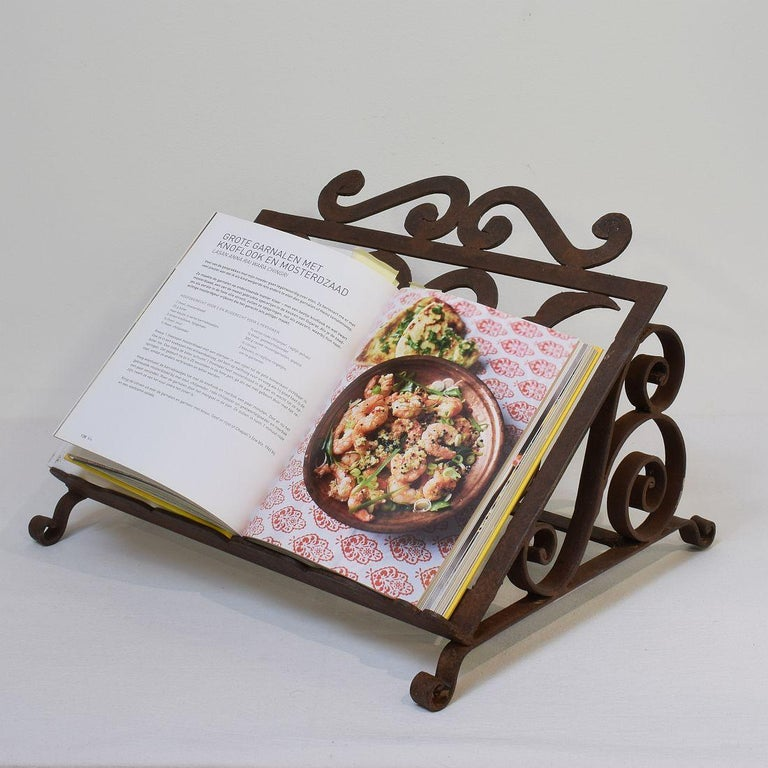 Beautiful hand forged iron lectern. Original period piece. Great to use in a kitchen for your cookbooks. Original period piece, Spain, circa 1880-1900. Weathered.
