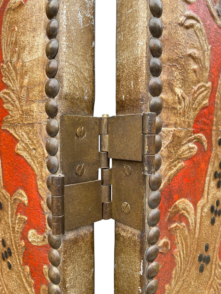 Signed Lapayase. Palmettes and scrolling decoration on a red ground with gold, green and blue painted decoration with brass tack framed borders.