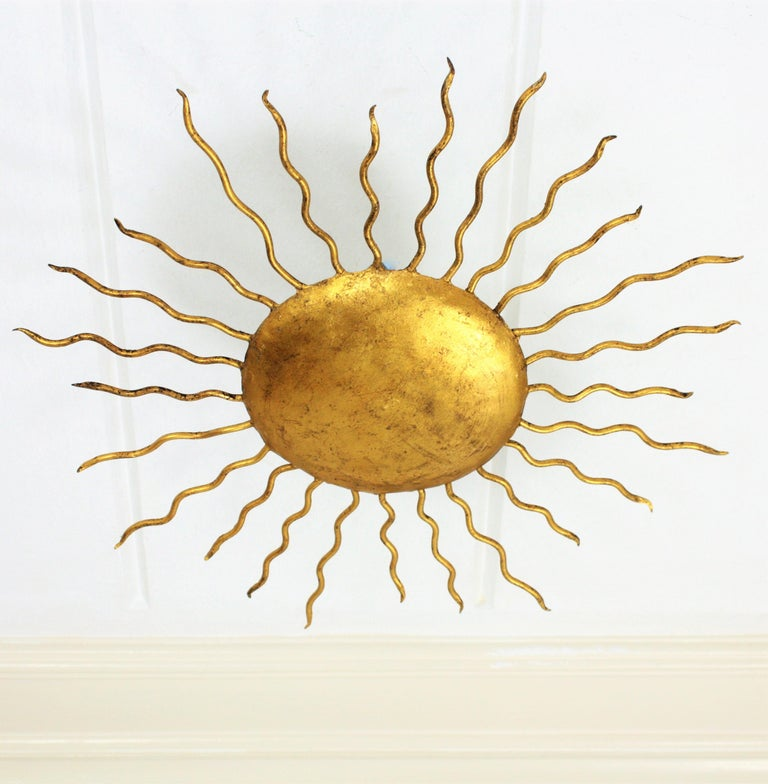 Spanish Medium Sized Hand-Hammered Gilt Iron Sunburst Flush Mount or Wall Light In Excellent Condition For Sale In Barcelona, ES