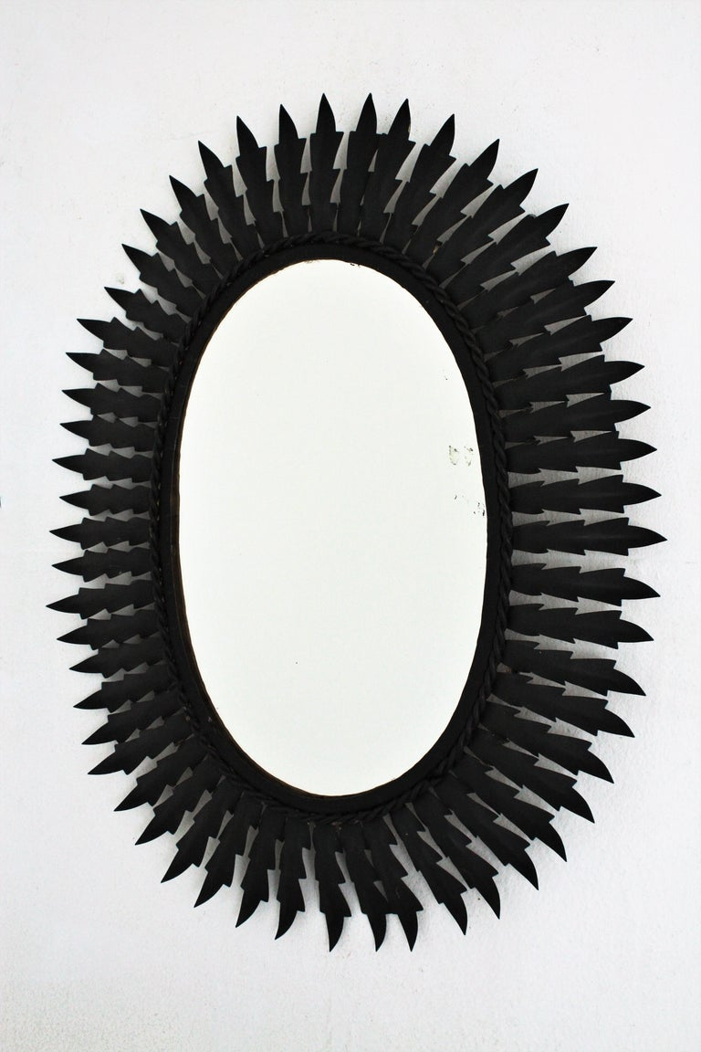 Spanish Metal Sunburst Oval Mirror Painted in Black, 1960s For Sale 2