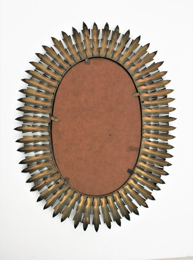 Spanish Metal Sunburst Oval Mirror Painted in Black, 1960s For Sale 4