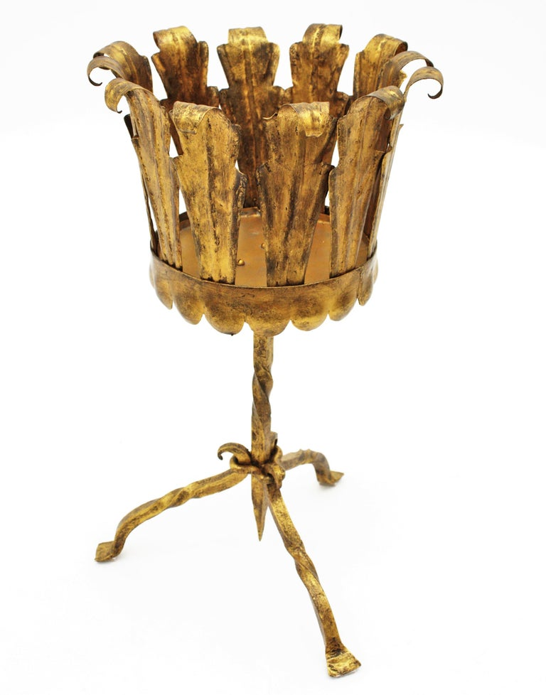Hand-hammered gilt iron leafed Gothic style planter manufactured at the Mid-Century Modern period, Spain, 1950-1960. Beautiful to place as a set with other gilt iron stands or gueridon tables. It can be used as a planter or bottle stand / bar