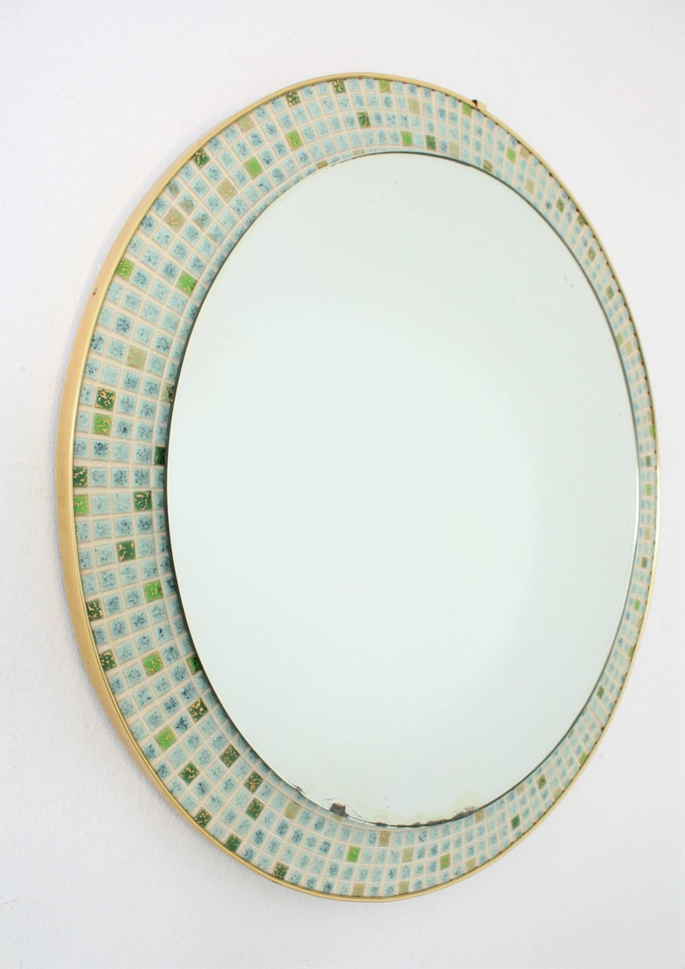 Midcentury circular mirror framed with small tiles in green and pastel blue colors. Handcrafted in Spain at the 1960s.